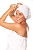 Beautiful woman tying up her wet hair Stock Photos