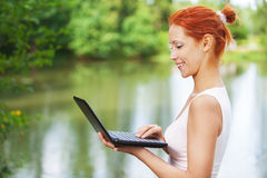Beautiful woman typing on laptop Royalty Free Stock Photography