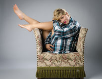 Beautiful woman on ugly old chair Stock Images