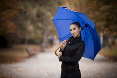 Beautiful woman with umbrella. Beautiful young woman holding blue umbrella stock images
