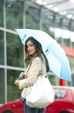 Beautiful woman with umbrella Stock Image