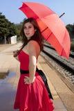 Beautiful woman with umbrella Stock Photography