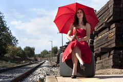 Beautiful woman with umbrella Stock Images
