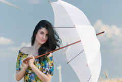 Beautiful woman with umbrella. The model name is Andreea Anghel - Photo taken in Braila - Romania Stock Images