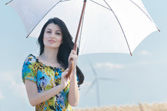 Beautiful woman with umbrella in the Rye Royalty Free Stock Photos