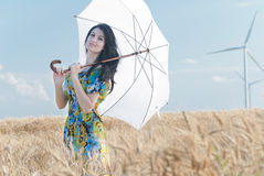 Beautiful woman with umbrella in the Rye. The model name is Andreea Anghel - Photo taken in Braila - Romania royalty free stock images