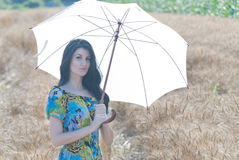 Beautiful woman with umbrella in the Rye Stock Photo