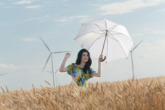 Beautiful woman with umbrella in the Rye Stock Images