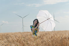 Beautiful woman with umbrella in the Rye. The model name is Andreea Anghel - Photo taken in Braila - Romania Stock Image