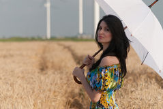 Beautiful woman with umbrella in the Rye. The model name is Andreea Anghel - Photo taken in Braila - Romania royalty free stock photos