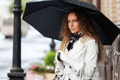 Beautiful fashion woman with umbrella on city street Royalty Free Stock Photos