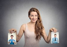 Beautiful woman undecided about which man to choose. Human emotions. Beautiful women undecided about which men to choose. Human emotions face expression Stock Photography