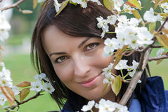 Beautiful woman under blooming tree Royalty Free Stock Image