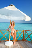 The beautiful woman under parasol near the sea Stock Image