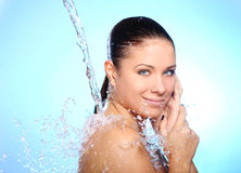 Beautiful woman under splash of water Stock Images