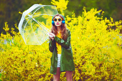 Beautiful woman under umbrella Stock Images
