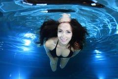 Beautiful woman underwater Stock Image