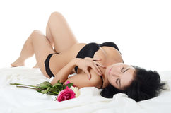 The beautiful woman in underwear with roses Royalty Free Stock Photography