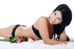 The beautiful woman in underwear with roses Stock Image