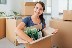 Beautiful woman unpacking in her new house Stock Photo