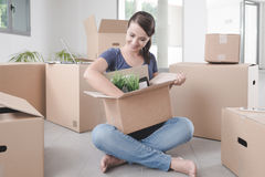Beautiful woman unpacking in her new house Stock Images