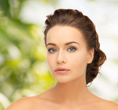 Beautiful woman with updo Stock Images