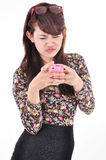 A beautiful woman is upset when carrying the phone Stock Image