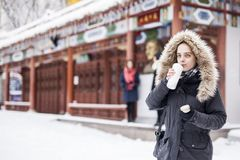 Beautiful woman in urban area during winter Stock Images