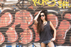Beautiful woman on urban background, rock lifestyle concept. Royalty Free Stock Image