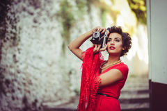 Beautiful woman in urban background. Vintage style Royalty Free Stock Images