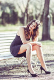 Beautiful woman in a urban park Stock Photos