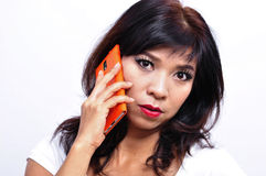 Beautiful woman uses mobile phone Stock Images