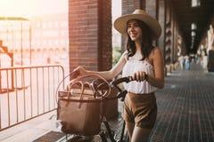 Beautiful woman using bicycle royalty free stock image