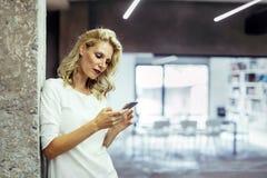 Beautiful woman using cell phone Stock Photos