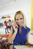 Beautiful Woman Using Cell Phone In Store Stock Image