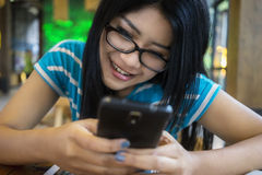 Beautiful woman using cellphone at cafe Stock Photography