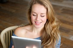 Beautiful woman using computer tablet Stock Photos