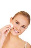 Beautiful woman using cotton pad Royalty Free Stock Photos