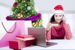 Beautiful woman using a credit card Stock Photo