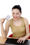Beautiful woman using credit card and laptop Stock Images