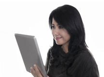 Beautiful woman using a digital tablet computer. Stock Photos