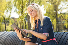 Beautiful woman using digital tablet Royalty Free Stock Images