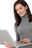 Beautiful woman using laptop computer Stock Images