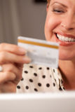 Beautiful Woman Using Laptop Holding Credit Card Stock Photo