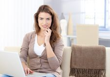 Beautiful woman using laptop at home Stock Photo