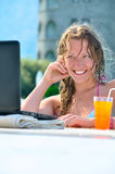 Beautiful woman is using laptop in pool Stock Photos