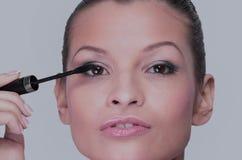 Beautiful woman is using mascara Royalty Free Stock Photography