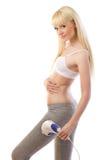 Beautiful  woman using massager Royalty Free Stock Photo