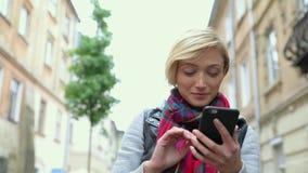 Beautiful Woman Using Mobile Phone At City Street stock video