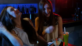 Beautiful woman using mobile phone at counter. In bar 4K stock video footage